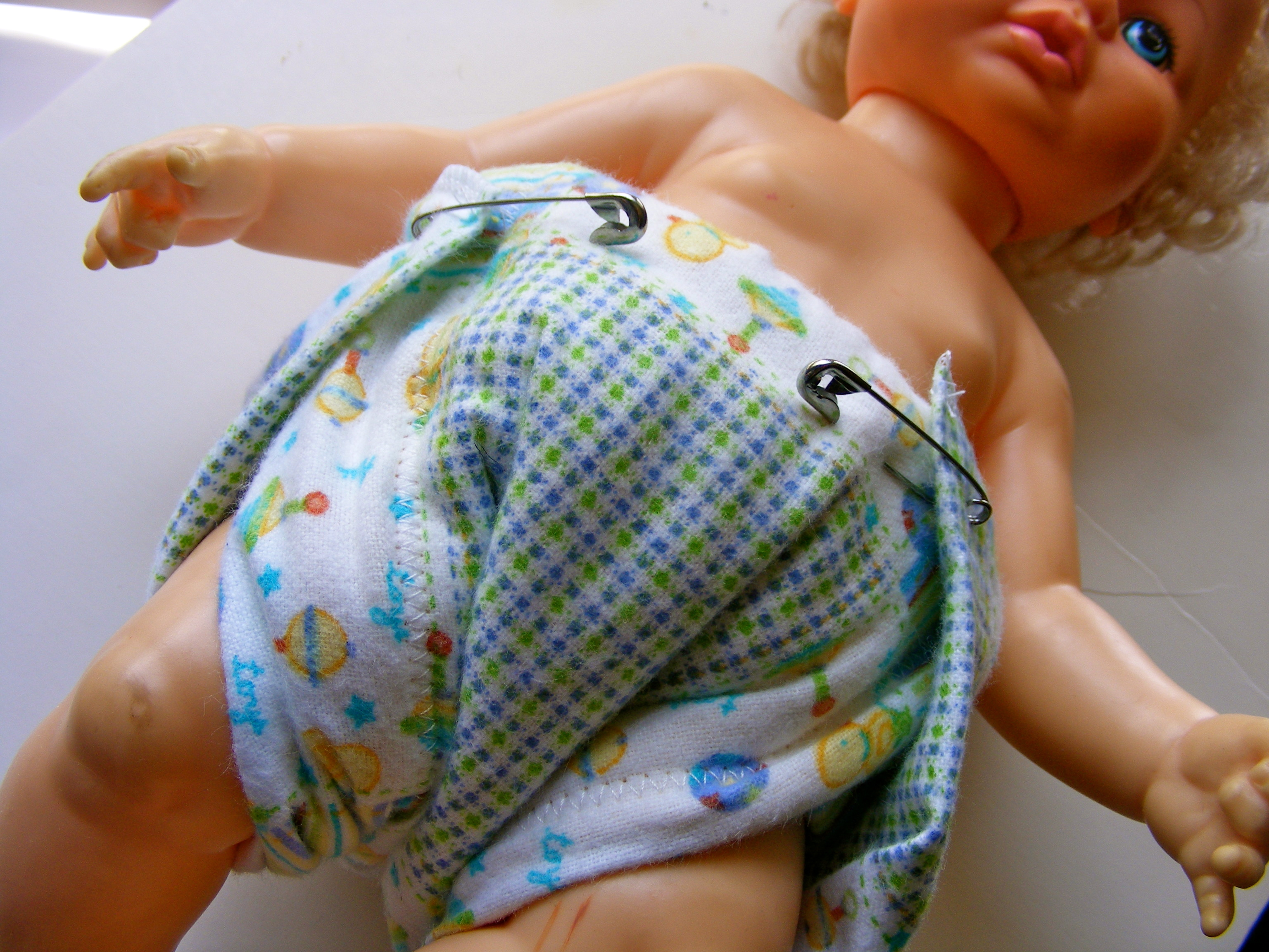 how to put on a prefold diaper with a snappi